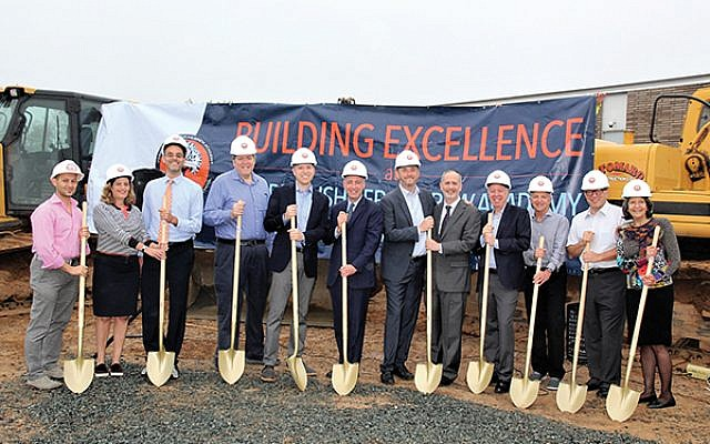 """Leaders donned hard hats and grabbed shovels to kick off construction of the """"Side Six"""" recreational facilities."""