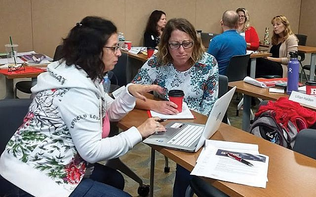 Teachers break into groups to discuss teaching methods for a program at Rutgers University's Herbert and Leonard Littman Holocaust Resource Center of the Bildner Center.