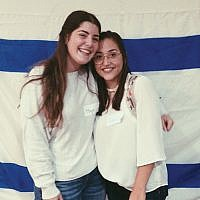 Shinshinim ambassadors Maya Shany, at left, and Dana Zachar meet the community at a federation-sponsored gathering in Marlboro Jewish Center. Photos courtesy the Jewish Federation in the Heart of NJ