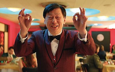 """Gaston Poon is one of the waiters in the Chinese restaurant who break into a hora in """"Dreaming of a Jewish Christmas."""" Photos courtesy Riddle Films Inc."""