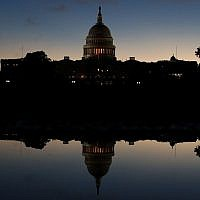The U.S. Capitol is reflected in a puddle of water a day after Americans voted in the  midterm elections, on November 7, 2018 in Washington, DC. Democrats have won control of the  House of Representatives while the U.S. Senate remains in Republican control.  (Photo by Mark Wilson/Getty Images)