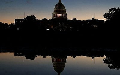 The U.S. Capitol is reflected in a puddle of water a day after Americans voted in the midterm elections, on November 7, 2018 in Washington, DC. Democrats have won control of the House of Representatives while the U.S. Senate remains in Republican control. Getty Images