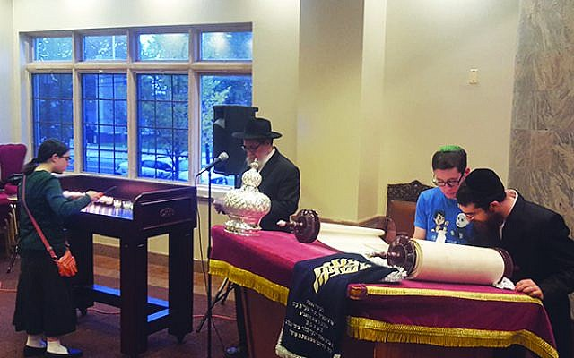 During a Torah dedication at Rutgers Chabad Oct. 28 the 11 victims of the Pittsburgh shooting were remembered by leaving the last 11 letters of the scroll blank. They were filled in during the ceremony by male students.