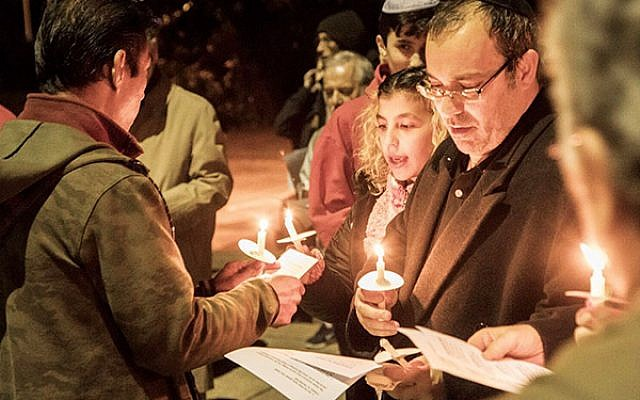 Hundreds of Highland Park residents gather outside the Reformed Church of Highland Park for a candlelight vigil. Photo courtesy of Mason Resnick Photography