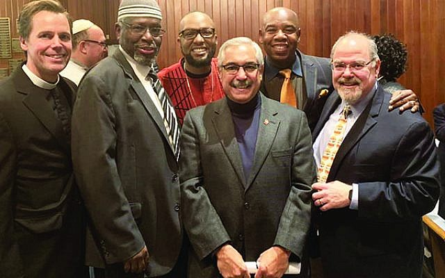 Rabbi Marc Kline, far right in front, is joined by other religious leaders during a vigil Oct. 29 at Monmouth Reform Temple in Tinton Falls that drew more than 1,000 people. Photo courtesy Monmouth Reform Temple