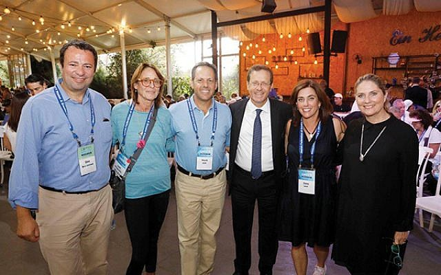 At Ein Hemed National Park are, from left, Dov Ben-Shimon, Lori Klinghoffer, Mark Wilf, Isaac Herzog, Jane Wilf, and Michal Herzog. Photos courtesy Jewish Federation of Greater MetroWest NJ