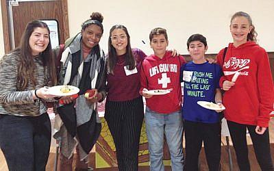 Chloe Valdary, second from left, is flanked by Maya Shany and Dana Zachar, federation's Israeli Teen Ambassadors, and summit participants. Photo Courtesy Jewish Federation in the Heart of NJ