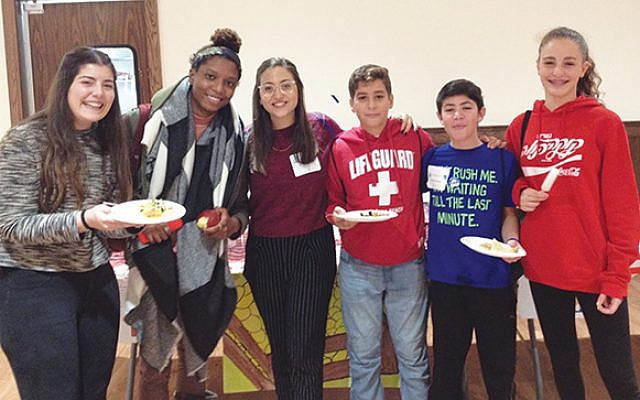 Chloe Valdary, second from left, is flanked by Maya Shany and Dana Zachar, federation's Israeli Teen Ambassadors, and summit participants. Photo Courtesy Jewish Federation in the Heart of NJ