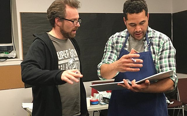 David Winitsky, left, works with actor Rafael Poueriet, who plays a student trying to reclaim his life in the aftermath of tragedy.  Photos courtesy Luna Stage