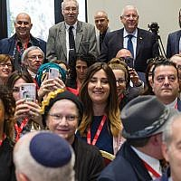 Man of the people: Israeli President Reuven Rivlin (back row, second from right) chose to go to the back of the crowded room to pose with the participants of the Jewish Media Summit at his residence Nov. 28. Courtesy Government Press Office