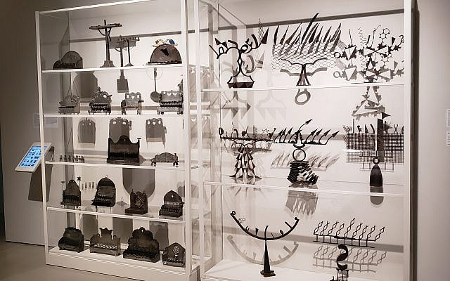 The exhibit includes eight whimsical menorahs crafted from scrap metal, left.  Photos courtesy Jewish museum/Braunstein: Sandee Brawarsky/JW