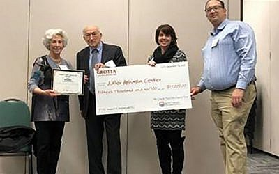 At the award presentation ceremony are, from left, Renie Carniol, director of the Grotta Fund; Chuck Berkowitz, chair of Adler Aphasia Center's board of directors; Chantelle Walker, the center's president and CEO; and Joshua Greenfield, a member of the Grotta Fund Council.