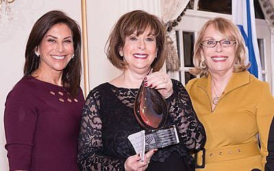 Former Women's Division director Debbie Schwartz, center, receives her Diamond Gala award from Debbie Janoff, at left, and Sharon Halpern. Photos by Robert Schneider/Israel Bonds