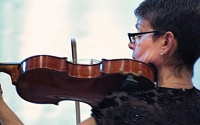 Tamara Freeman plays a viola owned by Tauba Botzel, a Jewish musician murdered in the Theresienstadt concentration camp. Courtesy Tamara Freeman