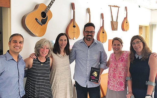 Ohn Cohen, director of the Arad Music Conservatory, left, and Arad Mayor Nisan Ben-Hamo give Women's Philanthropy professionals a tour of the facility in October.