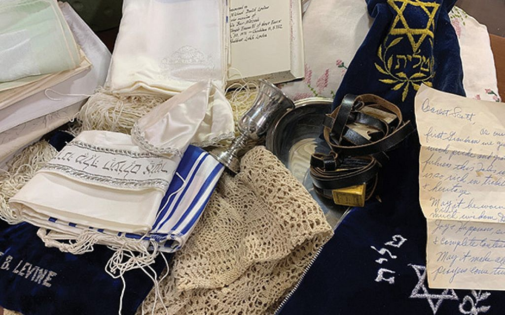 The cache of Judaica, serving pieces, and linens found in a locked drawer at the Randolph Habitat for Humanity ReStore. Photo by Johanna Ginsberg