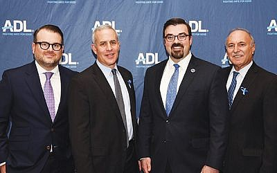 Jared Maples, director of NJOHSP, second from right, with Evan R. Bernstein, regional director New York/New Jersey ADL; Ross Pearlson, ADL New Jersey regional chair; and Roy Tanzman, ADL board member.