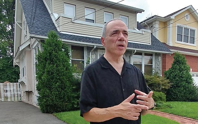 In front of the house he grew up in, Michael Takiff recalled the names of neighbors and playmates who lived nearby in the Elmora section of Elizabeth. Photos by Elaine Durbach