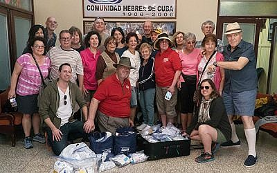 Seth Derma, back row, fourth from the left, with volunteers and donated medical supplies.