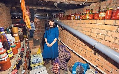 Shterney Kanelsky visits the basement where her husband hid from the Soviet authorities for two years as a child, in the family home in a Moscow suburb.  Photos courtesy Bris Avrohom