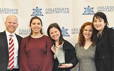 CMBD founder Abraham Waserstein, left, with members of the University of Washington debate team, from left, Nicole Jevons, Samantha Eden, Talya Gilboa, and Doria Nelson. The team won first prize in its division, which included students with limited Jewish textual background. (Photos by Michele Alperin)
