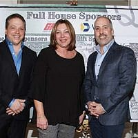 Susan Grosser, executive director, is flanked by David Silverstein, at left, co-chair and president of DOI's board of governors, and Gary Wayne, event co-chair and board member. (Photo by Bev Weiss)