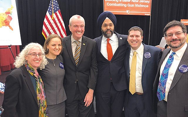 Gov. Phil Murphy and Attorney General Gurbir S. Grewal are flanked by rabbis, from left, Faith Joy Dantowitz of Temple B'nai Abraham in Livingston, Jennifer Schlosberg of the Glen Rock Jewish Center, Jesse Olitzky of Congregation Beth El in South Orange, and Joel Abraham of Temple Sholom in Scotch Plains.