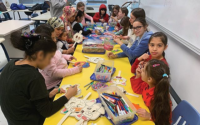 At Temple Emanu-El's Fun Club, children work on arts and crafts while their parents learn English. (Photos by Johanna Ginsberg)