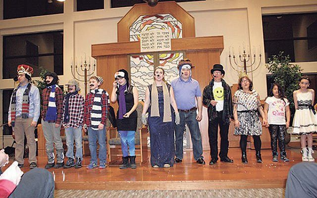 "The 2015 cast of the ""Frozen"" Purim spiel by Har Sinai Temple in Pennington; they used a script purchased from Temple Beth Miriam in Elberon. (Photo courtesy Har Sinai Temple)"