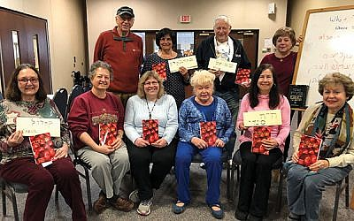 Ellen Muraskin, standing at right, with students in her Yiddish class including, seated, from left, Carol Shanik, Cookie Samuels, Lori Falco, Naomi Zaslow, Cindy Eskow, and Linda Forgosh. Standing, from left, are Larry Edelstein, Barbara Nappen, and Steve Nappen. Photo by Lisa Segelman