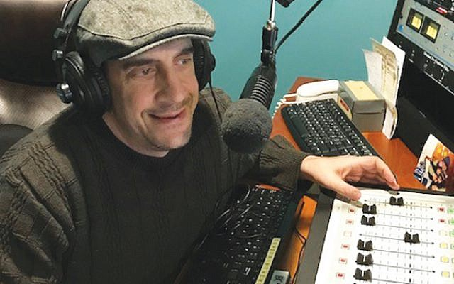 Michael Greenberg pre-records music for his weekly four-hour radio show, which features an eclectic array of Israeli, cantorial, and contemporary Jewish songs. (Photo courtesy Michael Greenberg)