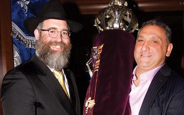 Rabbi Yehuda Spritzer, at left, with Danny Matarese and the Torah scroll dedicated in memory of Susan Barbara Korn Matarese.  Photo by Ed Hornichter