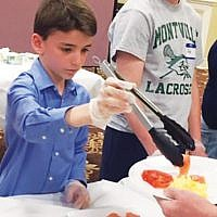 Pine Brook Jewish Center volunteers included Jake Wise and Jack Tlusty.  Courtesy PBJC