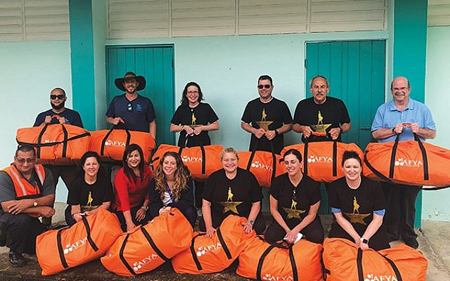 Leslie Dannin Rosenthal, standing, third from left, and her group brought 11 duffel bags filled with medical supplies to give to Puerto Ricans in isolated areas.