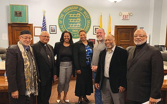 Rabbi Robert L. Tobin, third from right, with panel participants, from left, Mohammad Abassi, Rev. Miguel Hernandez, Tammy Williams, Rev. Dr. Carol Patterson, Pastor Douglas Adams, and Abdul Alim Mubarak-Rowe.