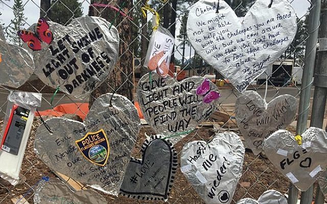 The community responds with a show of affection to vandalism at Chabad Jewish Community Center of Flagstaff, Ariz. KNAU Public Radio via Facebook