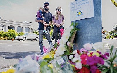 A makeshift memorial for the victims of the Chabad of Poway. A gunman inspired by white nationalists opened fire on Passover, killing one and injuring three. Getty Images