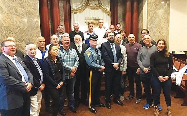 Israeli police officers joined community members and local law enforcement at Rutgers Chabad on the first night of their 250-mile bicycle ride to Washington, D.C. Photo by Debra Rubin