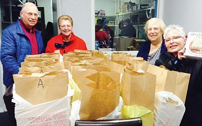 Volunteers prepare Passover bags to be distributed to families and individuals in need.