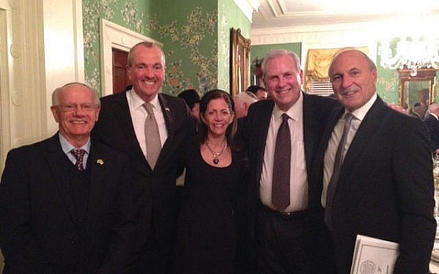 The NJ State Association of Jewish Federations with executive director Jacob Toporek, at left, will be dissolved at the end of June and replaced by the new Jewish Federations of New Jersey. Also pictured are Gov. Phil Murphy, Tammy Murphy, Steve Klinghoffer, and Roy Tanzman.  Courtesy State Association