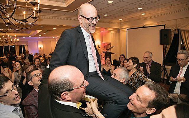 Senior Rabbi Elliott Tepperman, on chair, is feted at Bnai Keshet's annual gala. Dan Epstein