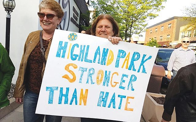 Marilyn Pruce, right, and Susan Slusky were among the 100 people marching through Highland Park to Rutgers Chabad. Photo by Debra Rubin