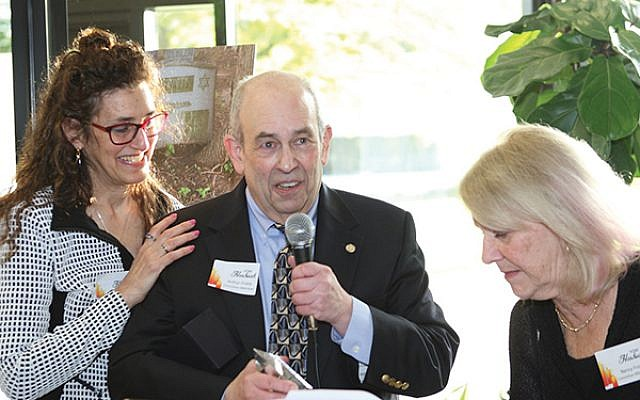 Lynne Azarchi presents Arthur Finkle, a leader in the cemetery project, with an award for drawing attention to Trenton's Jewish history through his books and blog.