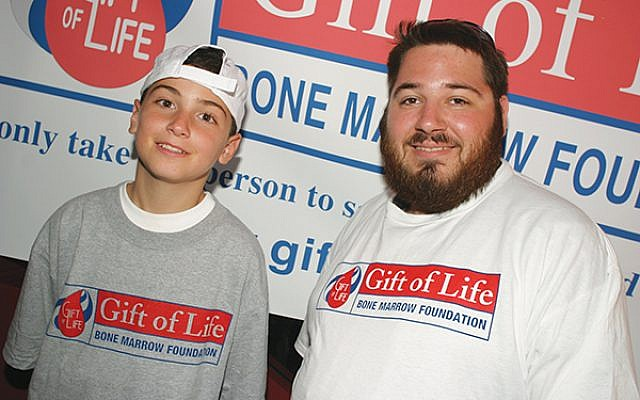 Samuel Aronoff, right, of Highland Park with Mark DeFrancesco Jr., during their first meeting at Shea Stadium in 2004. Aronoff, a Rutgers University student at the time, was a bone marrow donor for DeFrancesco, then 11. Photos courtesy NY Mets