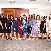 With guest speakers Goldie Plotkin and Melissa Ben-Ishay, eighth and ninth from left, are members of the Mikvah Chana event committee, from left, Dara Orbach, Esty Grossbaum, Celine Leeds, Barbara Listhaus, Joyce Weinberger, Mara Simons, Toba Grossbaum, Chevy Kaplitt, Sandy Steiner, Debbie Burack, Yonna Rosenberg, Rachel Joffe, and Chavi Rosenblum.