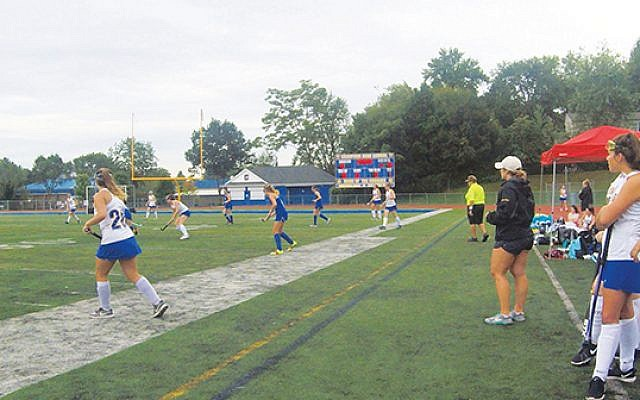 Samantha Berk, right, coaches her Cranford High School field hockey team during the 2019 season. Photos courtesy Samantha Berk