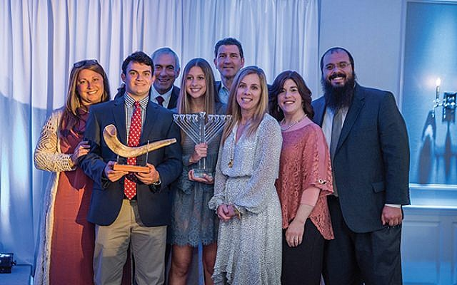 CTeen honorees with their families including, from left, Melissa Simon, Oliver Simon, Mark Simon, Sophia Smith, Doug Smith, Cecile Smith, Aharona Lubin, and Rabbi Shalom Lubin.