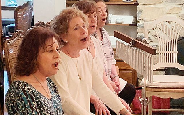 Choir members include, from left, Barbara Mayer, Enid Edelson, Yael Weinstein, and Debby Krasner. Photos by Johanna Ginsberg
