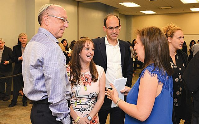 """Bill Lipsey, at left, founder of the Honey Foundation for Israel — a co-sponsor of """"Shtisel: Behind the Scenes"""" — and Honey Foundation president and daughter Sara Lipsey Brokman speak with best-selling author Dara Horn and her husband, Brendan Schulman."""