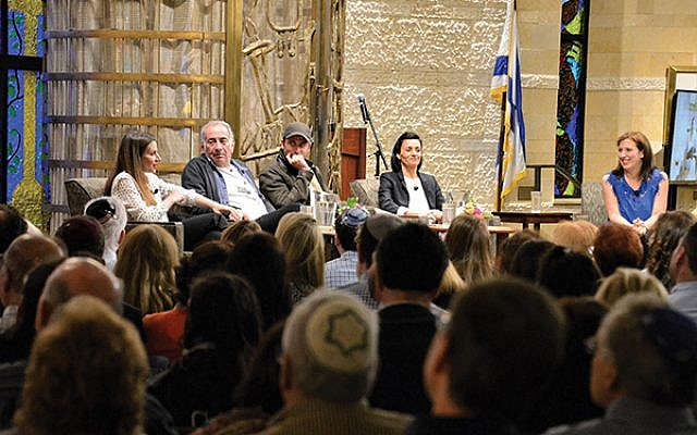 """A packed audience of more than 1,400 people filled the sanctuary at Congregation Agudath Israel in Caldwell for a panel discussion with """"Shtisel"""" co-stars, from left, Neta Riskin, Doval'e Glickman, and Michael Aloni; producer Dikla Barkai; and event moderator Dara Horn. Photos by Jerry Siskind"""